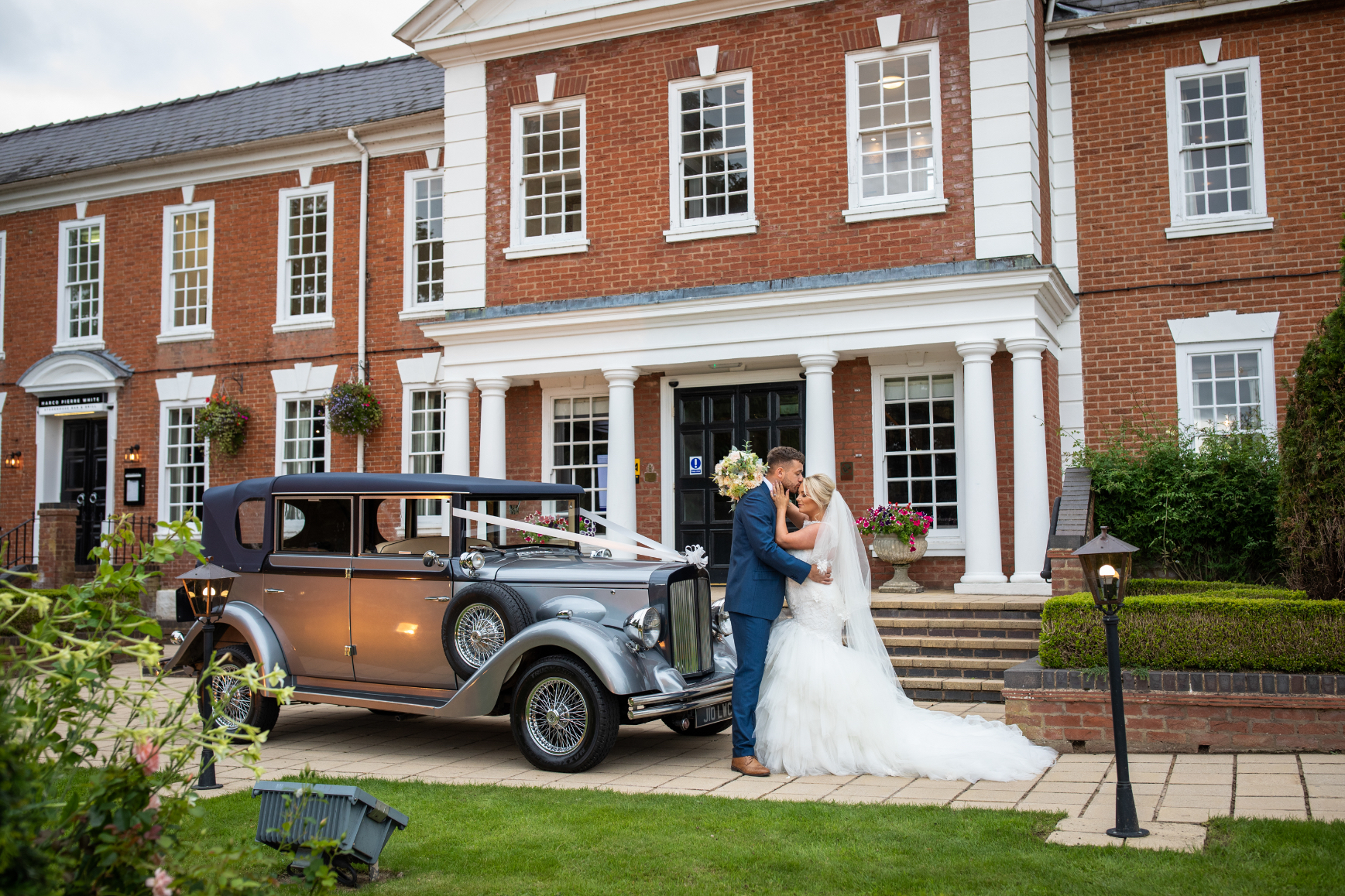 Bride and Groom and their car